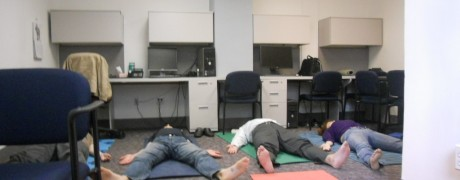 Folks relaxed in Savaasana -Yoga@Work at our research department