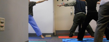 Getting into Triangle Pose under instructions from Marcela