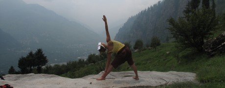 Doing a Trikon Asana (Triangle Pose) overlooking the Himalayan Mountains near Dharamshala, Himachal Pradesh